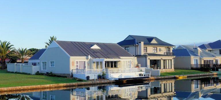 Single story house beside water