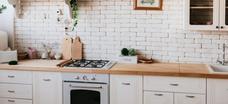 kitchen with a stove and flowers