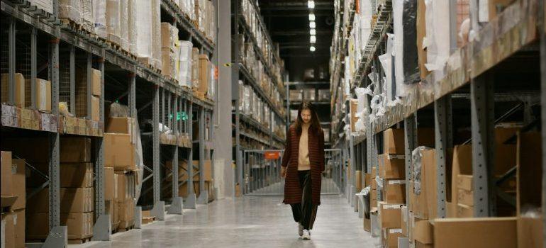 a woman walking in a warehouse