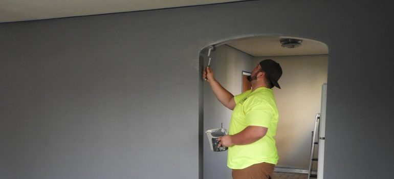 Picture of man painting walls