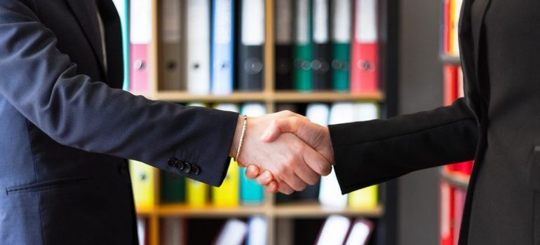 Two people shaking hands after hiring movers West Chester PA