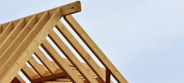 Picture of a roof wooden frame. Some of the big home renovations to complete before you move in are structural repairs