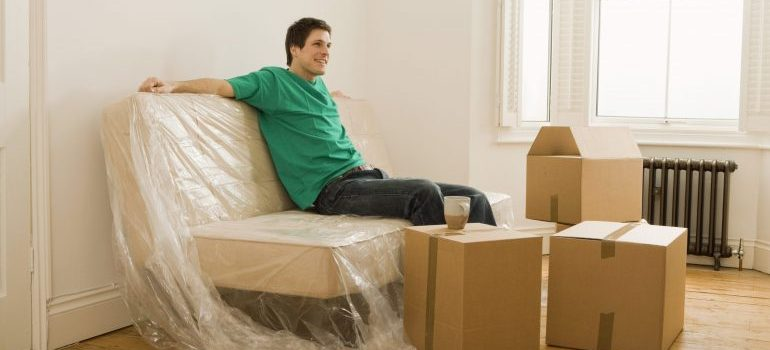 Picture of man taping boxes. If you wish to move sports equipment you must get quality moving supplies