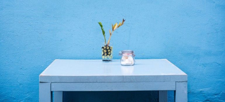 A blue table in front of a blue wall representing used decorating tips.