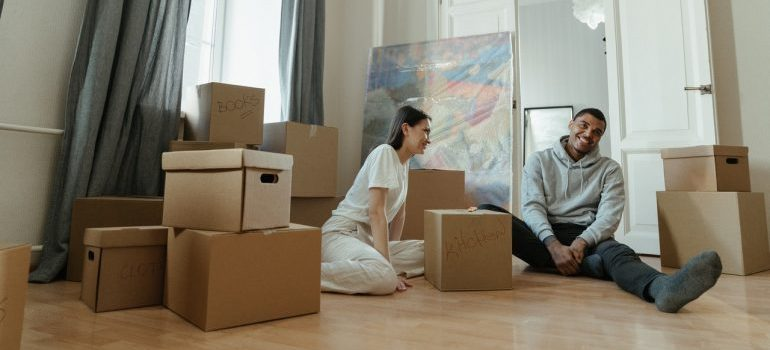 A couple using second hand boxes to reduce storage rental expenses