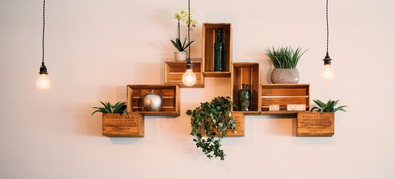 Crates mounted on a wall as shelves.