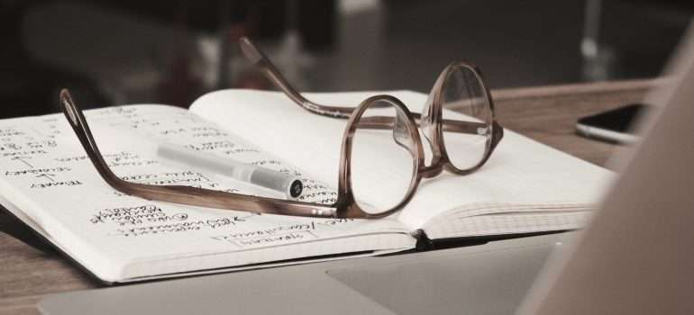 Glasses on the notebook.