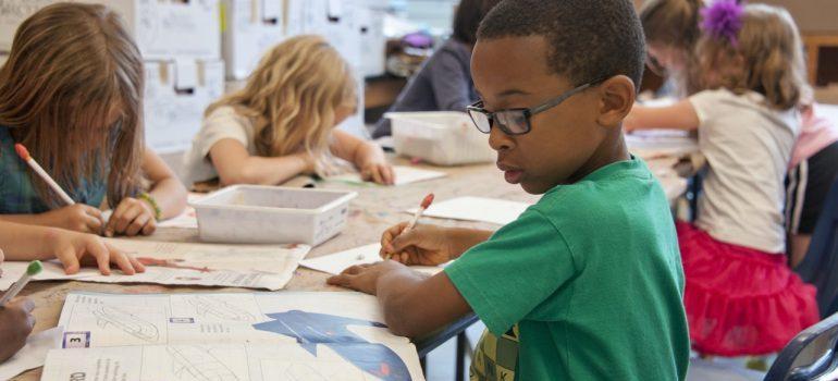 A little boy in school.