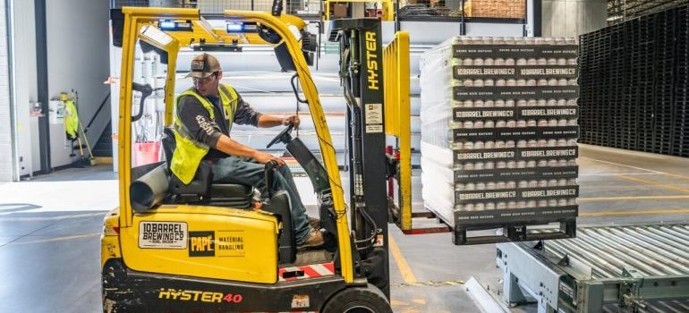 A man operating a forklift in a warehouse.