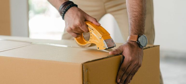 A professional packer handling the items of a client.