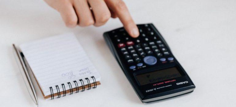 A calculator and a note,