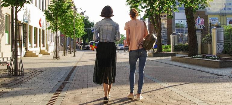 Two women walking around Glenside.