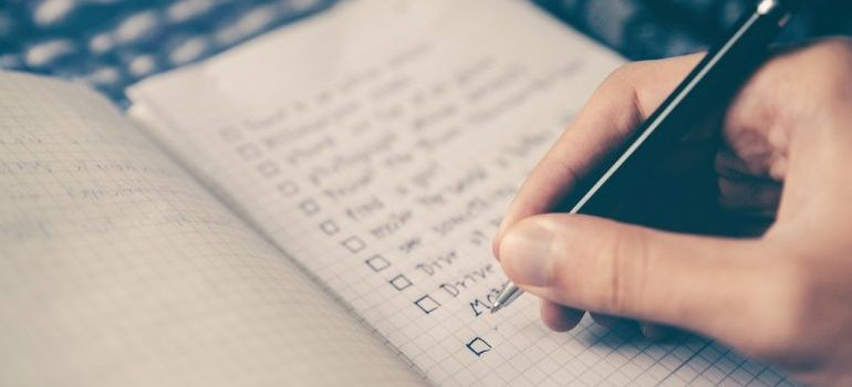 A person making a checklist when renting residential storage.