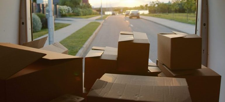 Moving boxes in a van.