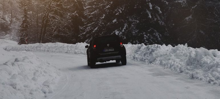A car on the snowy road
