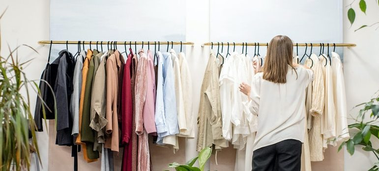 A woman browsing through her clothes