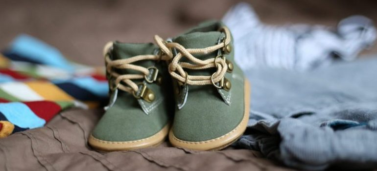 baby shoes on baby clothes