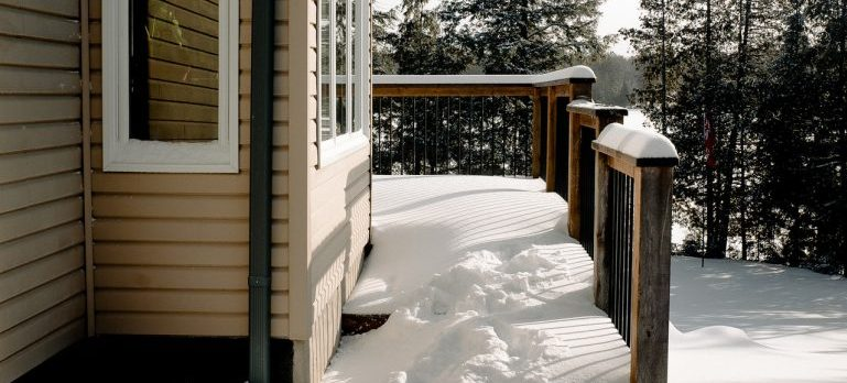 view of a home covered in snow