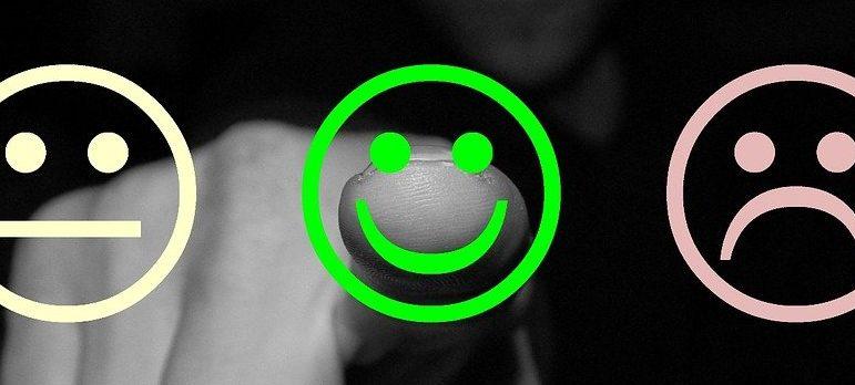 A person pointing toward a smiley face