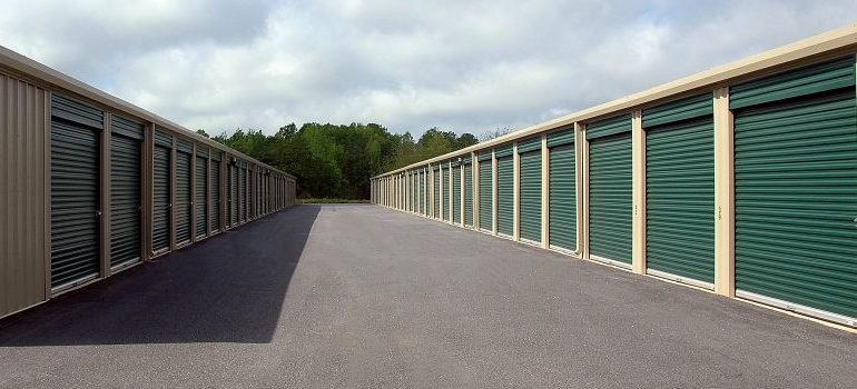Green doors to storage units out in the open