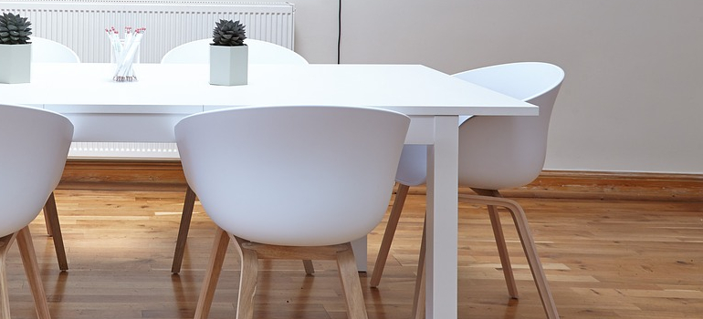 A white table and chairs