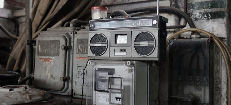 an old radio on top of an item inside a unit after the owner considered whether to store it or throw it away