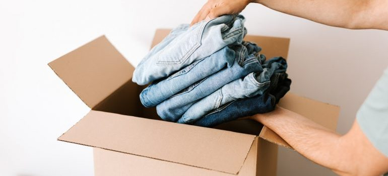 person packing moving box