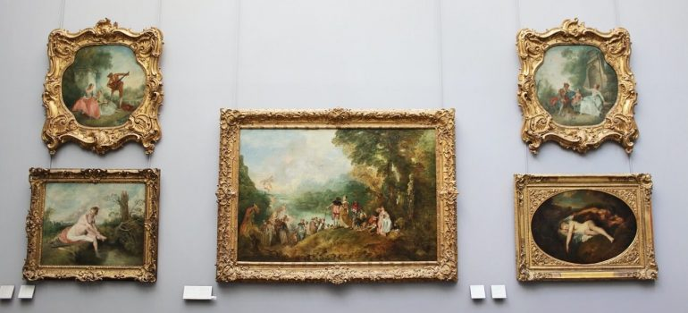 five antique paintings on the wall