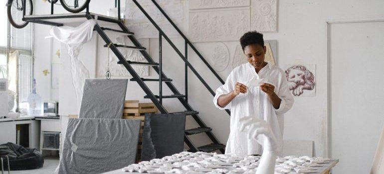 a woman making art