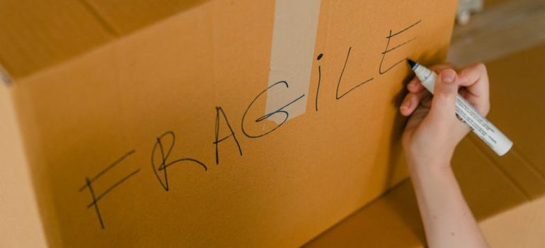 moving box with sign for fragile