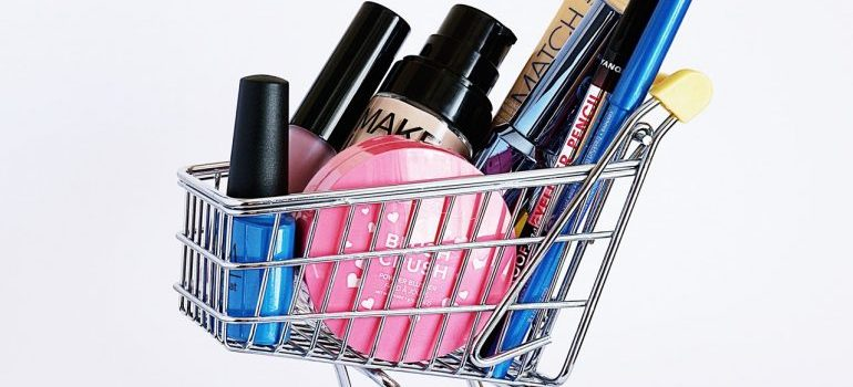 makeup products sorted and redy for packing makeup and toiletries