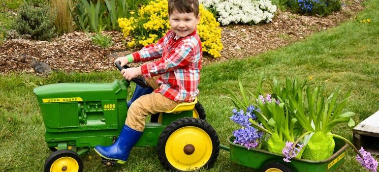 A child riding a toy lawnmower Items Movers Should Not Pack