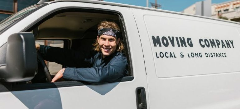 moving company worker in a moving van