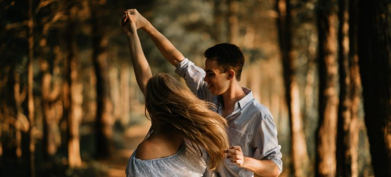 a couple dancing in the woods