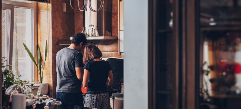 a couple preparing meals together as an example of ways to share your space with a partner