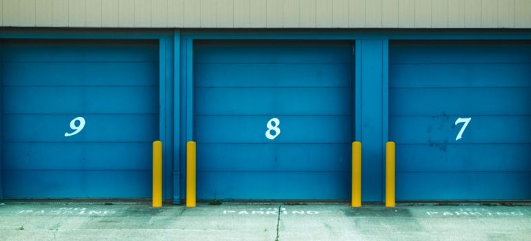 three doors to storage enterance with numbers on them