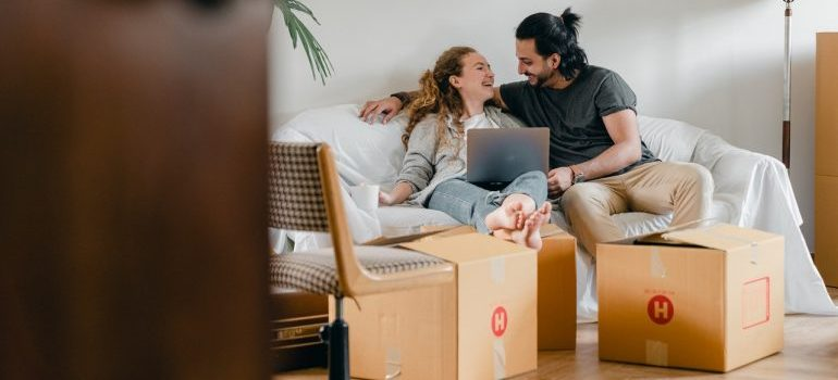 couple waiting for their local movers NYC