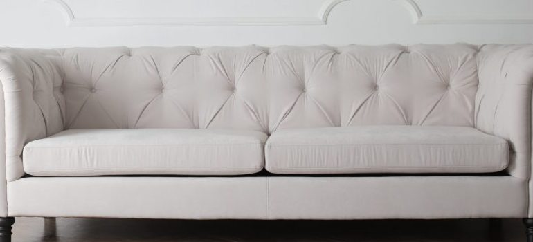 a white sofa that represents one of the best formal decoration ideas