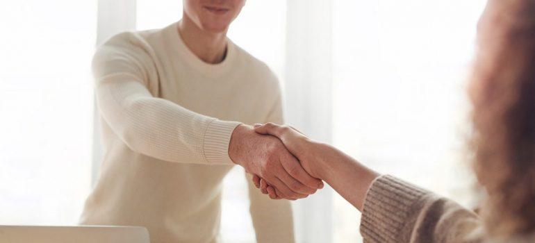 two people shaking hands after utilizing job opportunities in Conshohocken