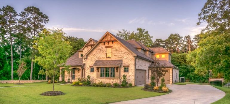 Luxurious beige house with a garded.