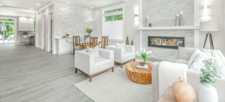 a spacious living room with white furniture in a house
