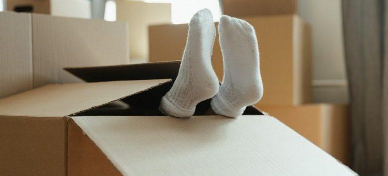 Toes peeking through a box