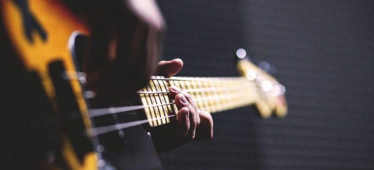 a man playin a bass guitar