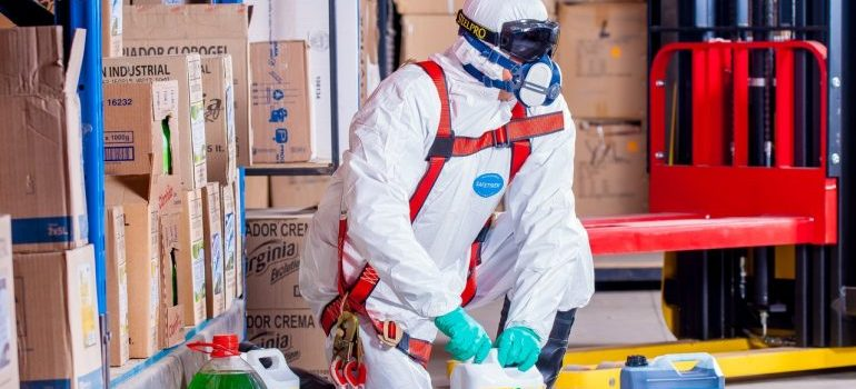 Guy with chemicals in a protective jumpsuit