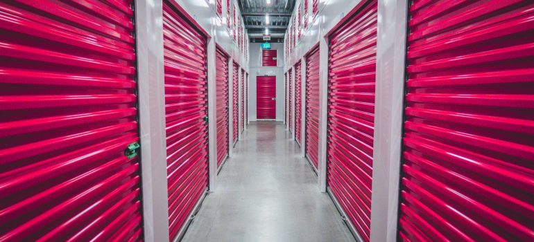 a picture of several storage units with purple doors