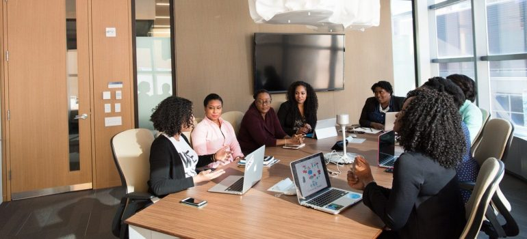 an office meeting between eight people as something to expect once you get a job in Media