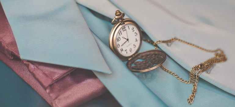 a pocket-watch on a silky fabric