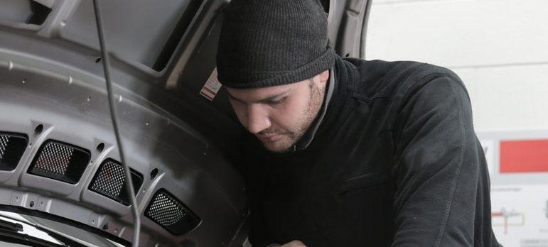 mechanic checking a vehicle