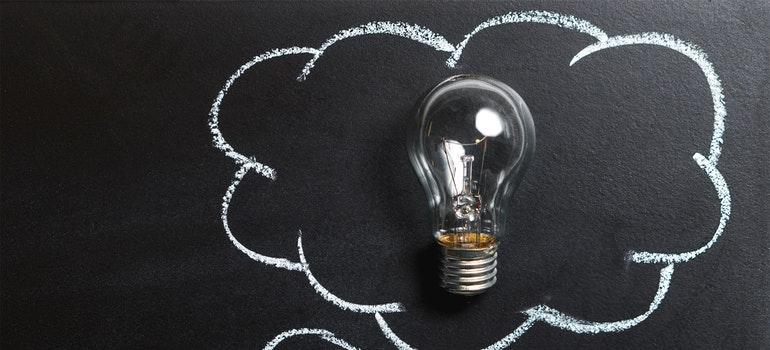 Light bulb on black paper