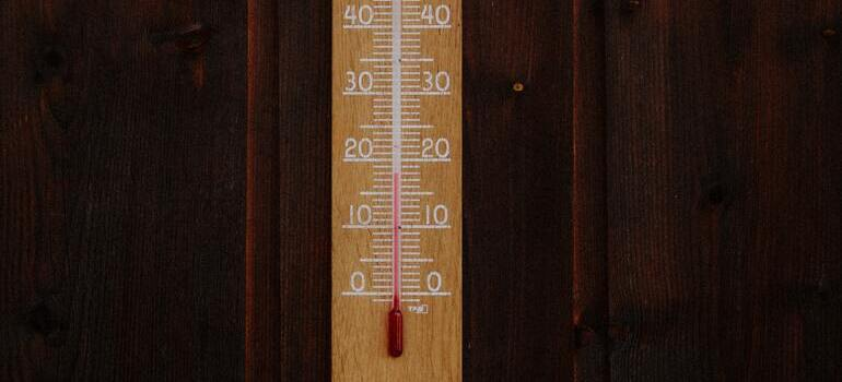 brown wooden thermometer
